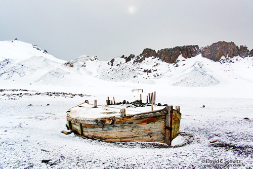 Old water boat at Whalers Bay on Deception Island, Antarctica