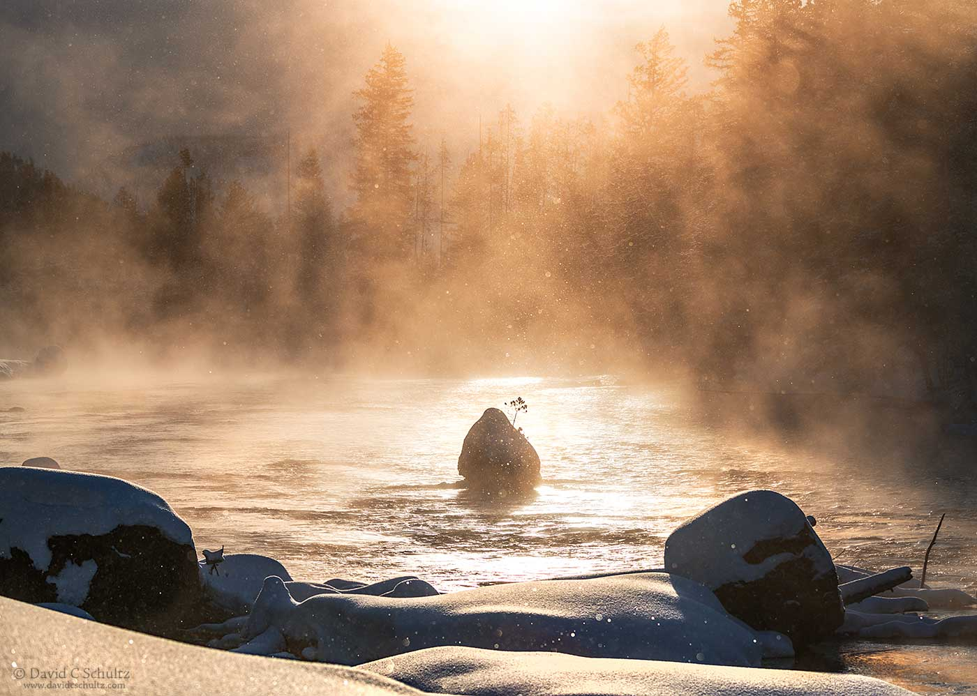 Steam coming off the Firehole river at sunrise.